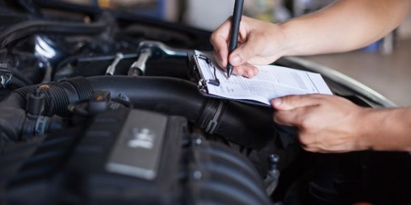 Nunawading Engine Clinic team member performing a pre-purchase vehicle inspection.
